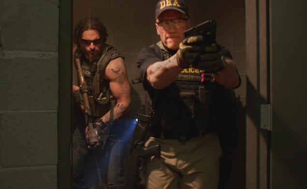 Arnold Schwarzenegger scowls his way through the Sabotage trailer