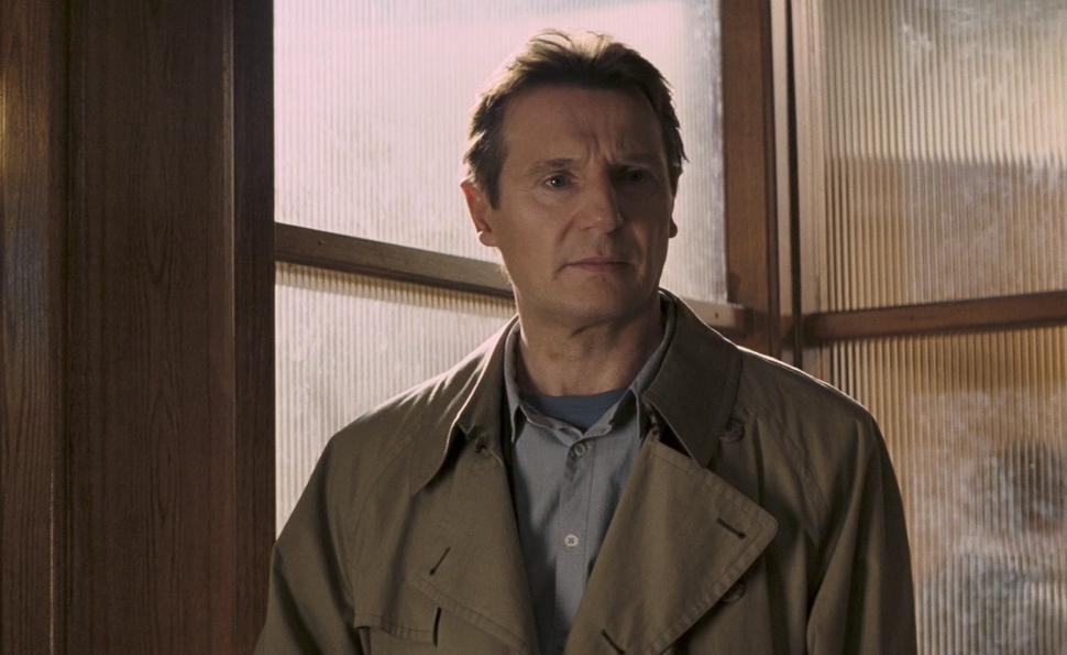 In The Other Man, man of action Liam Neeson stares at computer screens